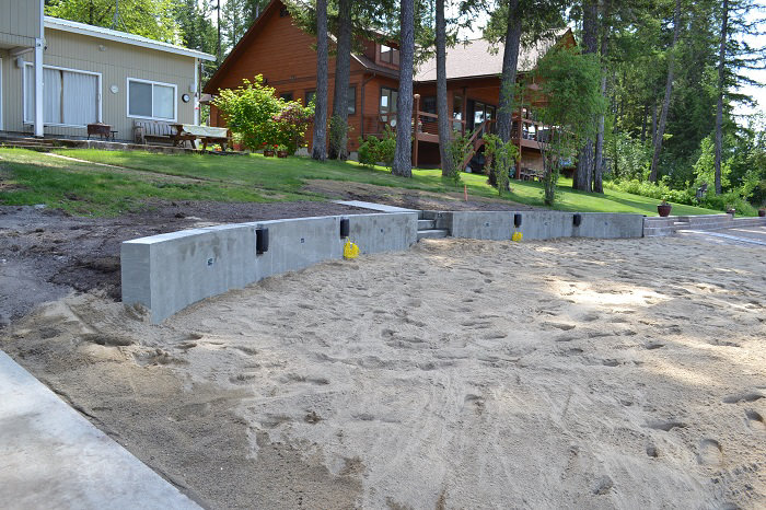Poured Concrete Retaining Walls : Contractor builds cultured stone curved retaining wall